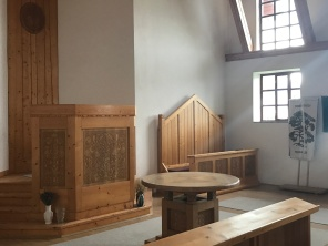 There are honour pews in every church where the ministers sit before ascending to the pulpit. Respected guests will sit in the honour pew to the left of the pulpit.